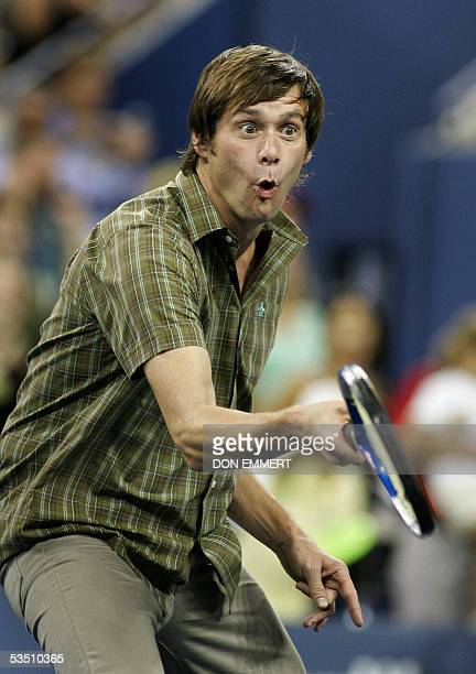 US actor Jim Carrey reacts after hitting a ball into the crowd during a break in action at the US Open 29 August 2005 in Flushing Meadows NY AFP...