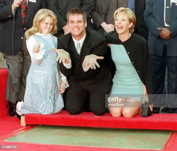 Actor Jim Carrey shows his hands after putting them in cement during his hand and foot print ceremony outside the famous Mann's Chinese Theatre 02...