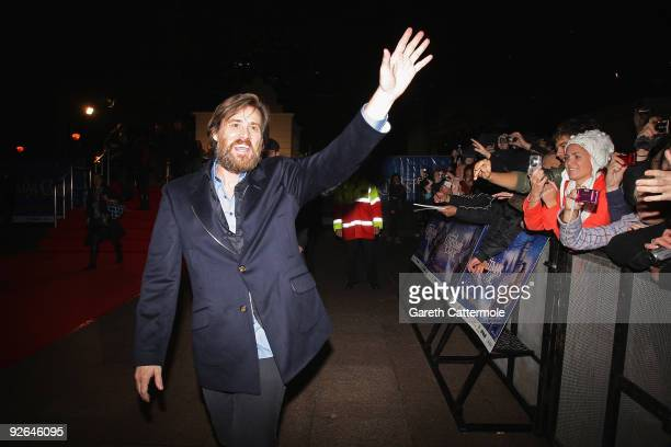Actor Jim Carrey waves to the fans during the World Film Premiere of Disney's 'A Christmas Carol' at the Odeon Leicester Square on November 3 2009 in...