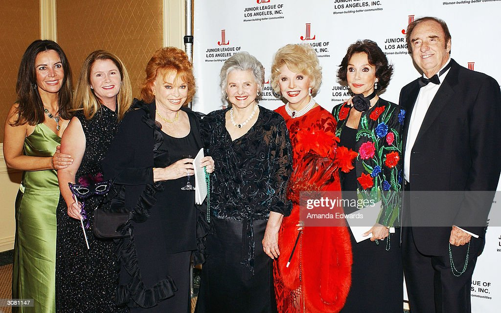 Actor Jim Nabors poses with Deborah George, Wendi Woods Chandler, Paula Kent Meehan, Caroline Rose Hunt, Ruta Lee and Mary Ann Mobley (L-R) at the Junior League of Los Angeles Carnivale Gala on March 12, 2004 at the Regent Beverly Wilshire in Beverly Hills, California.