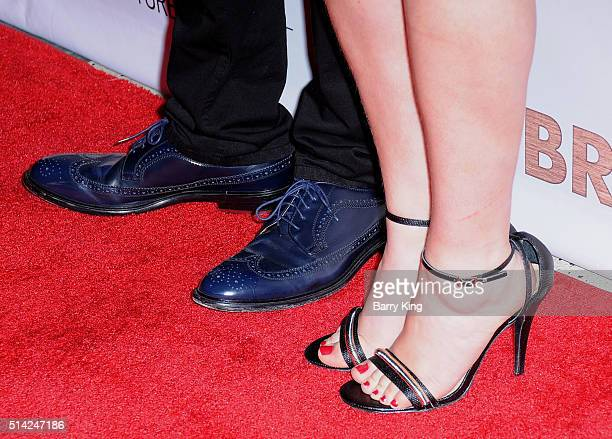 Actor Jim Parsons and actress Mayim Bialik shoe detail attend the Premiere of Sony Pictures Classics' 'The Bronze' at SilverScreen Theater at the...