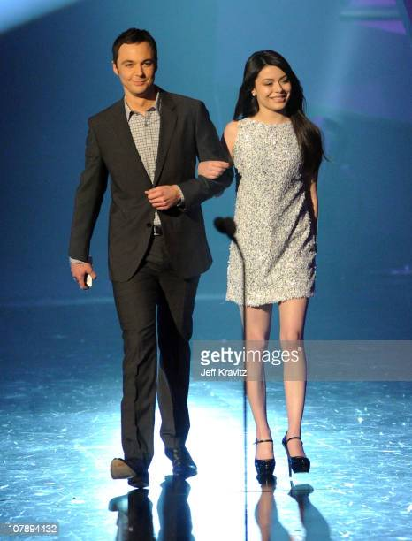 Actor Jim Parsons and actress Miranda Cosgrove walk onstage during the 2011 People's Choice Awards at Nokia Theatre LA Live on January 5 2011 in Los...