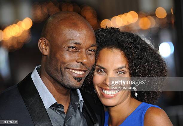 Actor Jimmy JeanLouis and Evelyn JeanLouis pose for photographers as they arrive on the red carpet for the premiere of the new Universal Pictures...