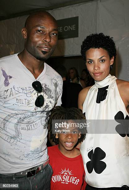 Actor Jimmy JeanLouis son Thevi and wife Evelyn attend MercedesBenz Fashion Week held at Smashbox Studios on March 13 2008 in Culver City California