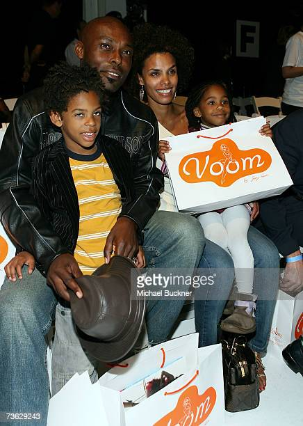 Actor Jimmy JeanLouis son Thevi wife Evelyn and daughter Jasmine pose in the front row at the Voom by Joy Han Fall 2007 fashion show during Mercedes...