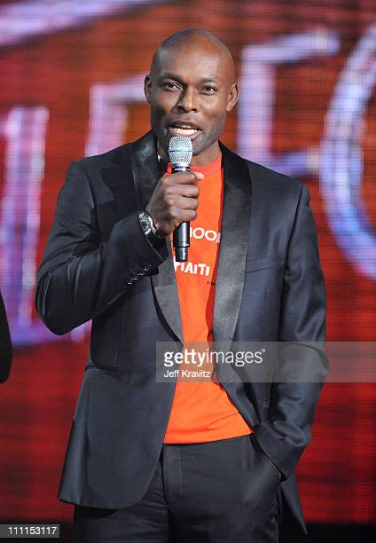 Actor Jimmy JeanLouis speaks onstage at the BETSOS Saving Ourselves Help for Haiti Benefit Concert at AmericanAirlines Arena on February 5 2010 in...