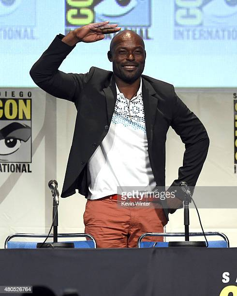 Actor Jimmy JeanLouis waves to audience onstage at the 'Heroes Reborn' exclusive extended trailer and panel during ComicCon International 2015 at the...