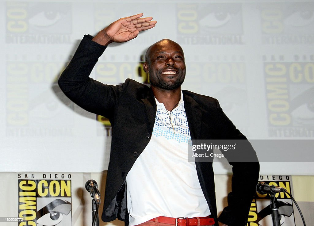 Actor Jimmy Jean-Louis waves to audience onstage at the 'Heroes Reborn' exclusive extended trailer and panel during Comic-Con International 2015 at the San Diego Convention Center on July 12, 2015 in San Diego, California.
