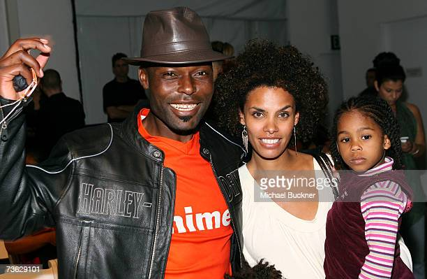 Actor Jimmy JeanLouis wife Evelyn and daughter Jasmine pose in the front row at the Voom by Joy Han Fall 2007 fashion show during Mercedes Benz...