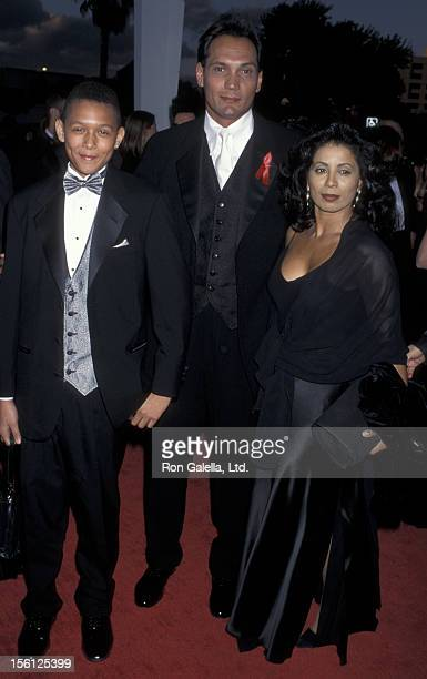 Actor Jimmy Smits son Joaquin Smits and Wanda De Jesus attending Second Annual Screen Actors Guild of America Awards on February 24 1996 at the Santa...