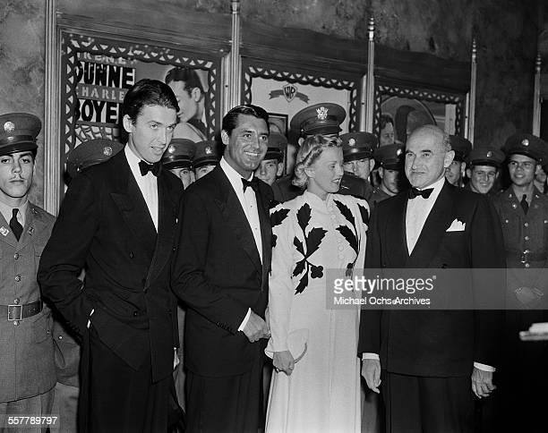 Actor Jimmy Stewart actor Cary Grant and film producer Samuel Goldwyn pose at the premiere of 'The Philadelphia Story' in Los Angeles California