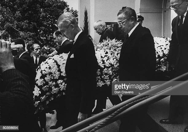 Actor Jimmy Stewart movie producer William Goetz and comedian Jack Benny carrying coffin of actor Gary Cooper