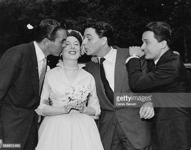 Actor Jimmy Thompson smiling as actor Tyrone Power and entertainer Bob Monkhouse kiss his bride Nina Binckley on their wedding day at St Albans...