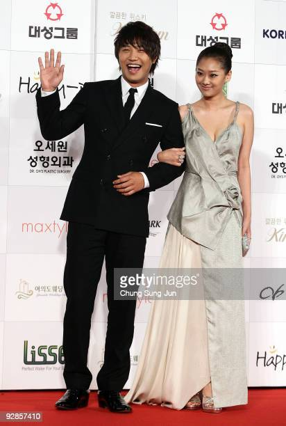 Actor Jin Goo and actress Juni arrive at the 46th Daejong Film Awards at Olympic Hall on November 6 2009 in Seoul South Korea