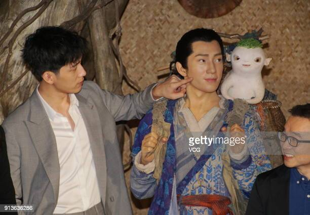 Actor Jing Boran poses with his wax figure during the unveiling ceremony at Madame Tussauds on February 3 2018 in Shanghai China