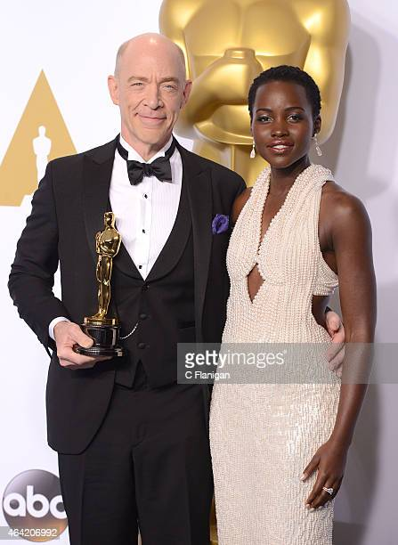 Actor J.K. Simmons and Actress Lupita Nyong'o pose in the Press Room during the 87th Annual Academy Awards at Loews Hollywood Hotel on February 22,...