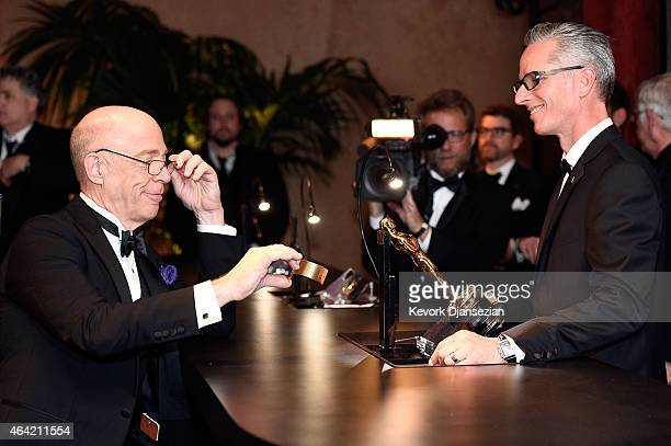 Actor JK Simmons has his Oscar Statuette engraved during the 87th Annual Academy Awards Governors Ball at Hollywood & Highland Center on February 22,...