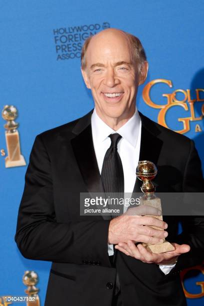 US actor JK Simmons poses in the press room with his award for Best Performance by an Actor in a Supporting Role in a Motion Picture for his role in...
