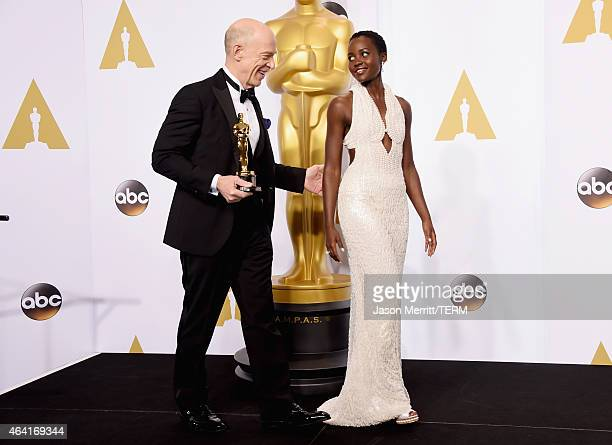 Actor JK Simmons winner of Best Actor in a Supporting Role for Whiplash and actress Lupita Nyong'o pose in the press room during the 87th Annual...