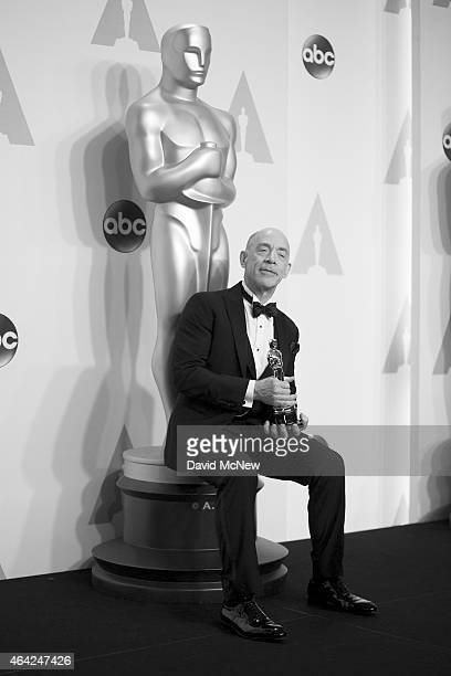 Actor J.K. Simmons, winner of the award for best actor in a supporting role for the film 'Whiplash' appears in the press photo room at the 87th...