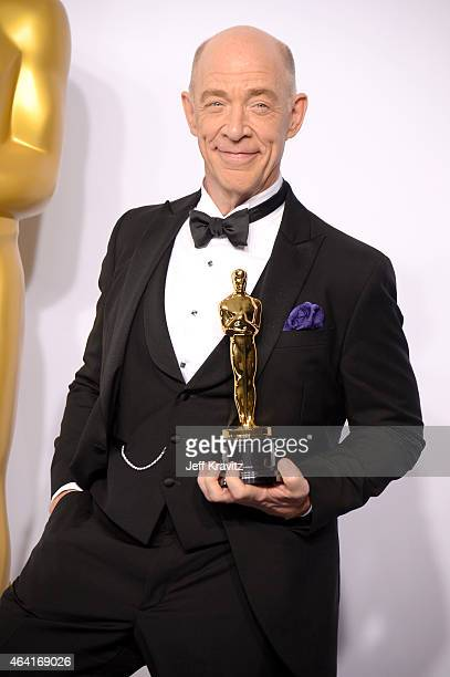 Actor JK Simmons with the award for best actor in a supporting role for the film Whiplash poses in the press room during the 87th Annual Academy...