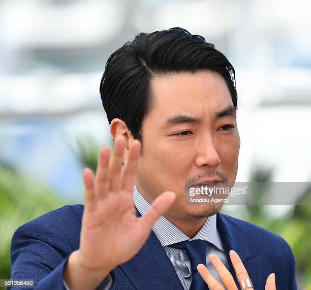 Actor Jo JingWoong poses during the photocall for the film 'The Handmaiden ' at the 69th international film festival in Cannes on May 14 2016
