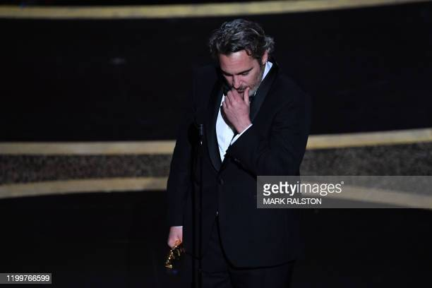 TOPSHOT US actor Joaquin Phoenix accepts the award for Best Actor in a Leading Role for Joker during the 92nd Oscars at the Dolby Theatre in...