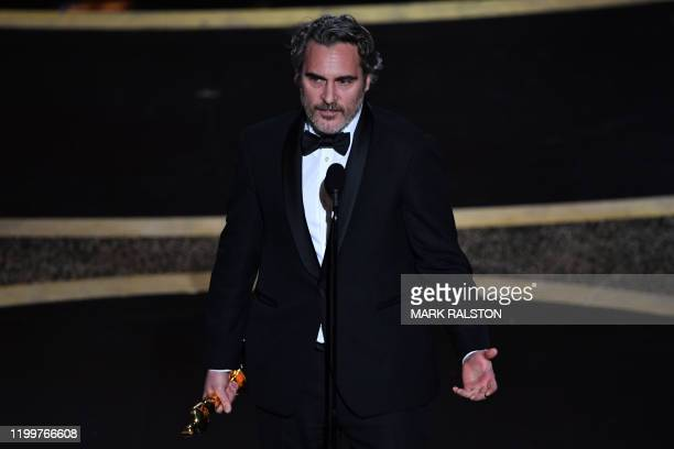 US actor Joaquin Phoenix accepts the award for Best Actor in a Leading Role for Joker during the 92nd Oscars at the Dolby Theatre in Hollywood...