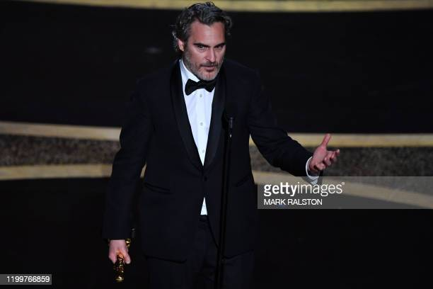 US actor Joaquin Phoenix accepts the award for Best Actor in a Leading Role for Joker onstage during the 92nd Oscars at the Dolby Theatre in...