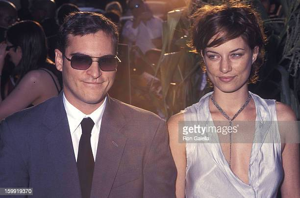 Actor Joaquin Phoenix and date Topaz PageGreen attend the Signs New York City Premiere on July 29 2002 at Alice Tully Hall Lincoln Center in New York...