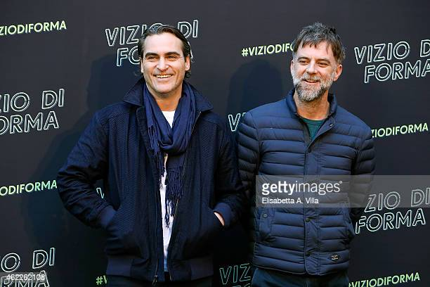 Actor Joaquin Phoenix and director Paul Thomas attend 'Vizio Di Forma Inherent Vice' photocall at Hotel De Russie on January 26 2015 in Rome Italy