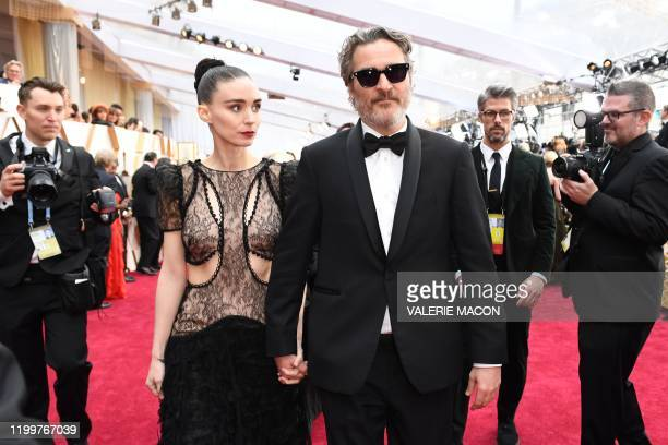 US actor Joaquin Phoenix and US actress Rooney Mara arrive for the 92nd Oscars at the Dolby Theatre in Hollywood California on February 9 2020