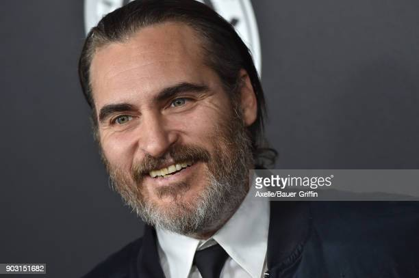 Actor Joaquin Phoenix arrives at The Art of Elysium's 11th Annual Celebration Heaven at Barker Hangar on January 6 2018 in Santa Monica California