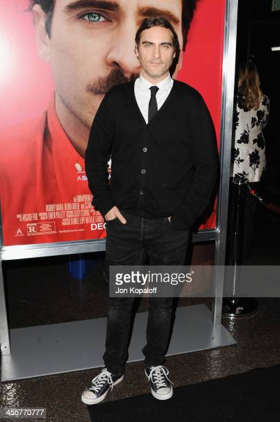 Actor Joaquin Phoenix arrives at the Los Angeles Premiere 'Her' at Directors Guild Of America on December 12 2013 in Los Angeles California