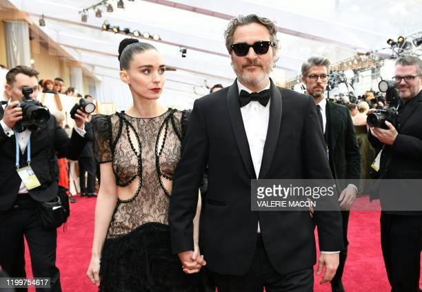 US actor Joaquin Phoenix arrives with Rooney Mara for the 92nd Oscars at the Dolby Theatre in Hollywood California on February 9 2020