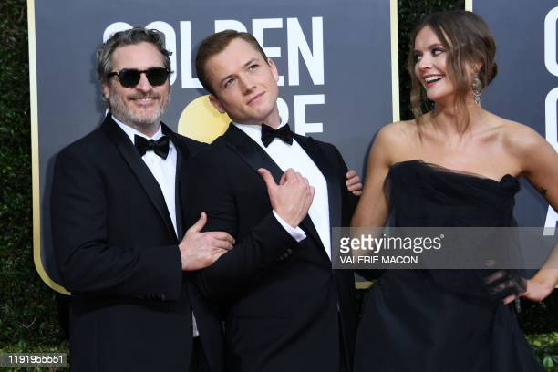 US actor Joaquin Phoenix British actor Taron Egerton Emily Thomas arrive for the 77th annual Golden Globe Awards on January 5 at The Beverly Hilton...