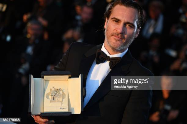 US actor Joaquin Phoenix poses during the Award Winners photocall after he won the Best Performance by an Actor award and for 'You Were Never Really...