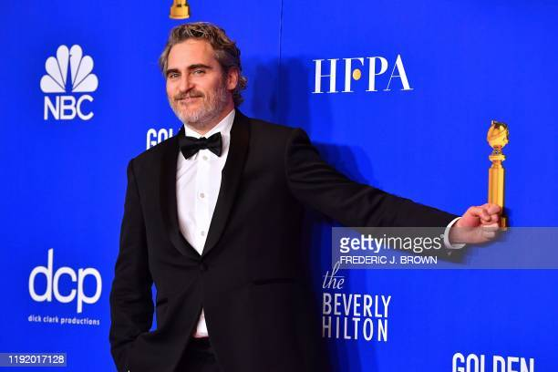 TOPSHOT US actor Joaquin Phoenix poses in the press room after winning the award for Best Performance by an Actor in a Motion Picture Drama during...