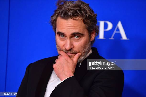 US actor Joaquin Phoenix poses in the press room after winning the award for Best Performance by an Actor in a Motion Picture Drama during the 77th...