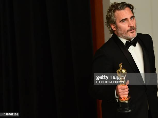 "Actor Joaquin Phoenix poses in the press room with the Oscar for Best Actor for ""Joker"" during the 92nd Oscars at the Dolby Theater in Hollywood,..."