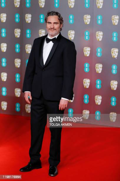 US actor Joaquin Phoenix poses on the red carpet upon arrival at the BAFTA British Academy Film Awards at the Royal Albert Hall in London on February...