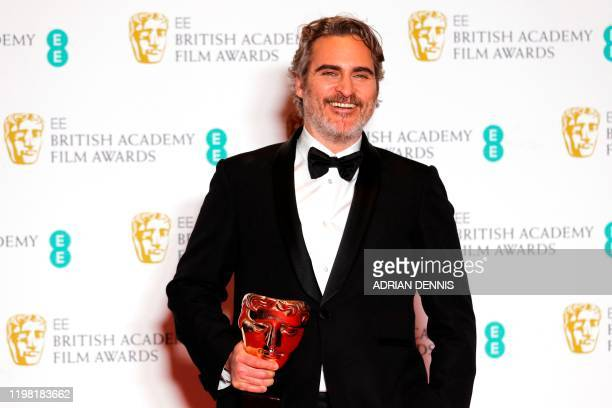 Actor Joaquin Phoenix poses with the award for a Leading Actor for his work on the film 'Joker' at the BAFTA British Academy Film Awards at the Royal...