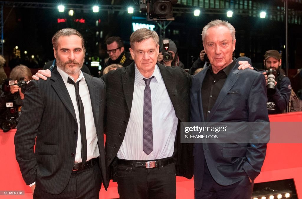US actor Joaquin Phoenix, US film director and screenwriter Gus Van Sant and German actor Udo Kier pose on the red carpet for the premiere of the film 'Don't Worry, He Won't Get Far on Foot' presented in competition during the 68th edition of the Berlinale film festival in Berlin on February 20, 2018. / AFP PHOTO / Stefanie Loos