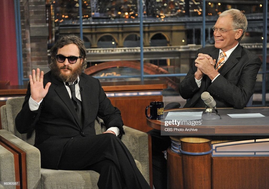 Actor Joaquin Phoenix, waves to the audience during his interview with Late Show host David Letterman during the Late Show with David Letterman Wednesday, February 11, 2009 on the CBS Television Network.