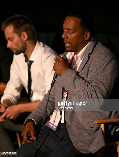 Actor Joe Anderson and director Deon Taylor speak onstage during the Supremacy premiere during the 2014 Los Angeles Film Festival at Regal Cinemas LA...
