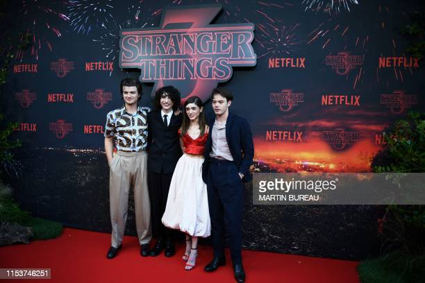 US actor Joe Keery Canadian actor Finn Wolfhard US actress Natalia Dyer and British actor Charlie Heaton pose during a photocall for the premiere of...