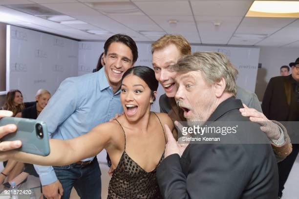 Actor Joe Locicero host Gina Rodriguez actor Doug Jones and actor Mark Hamill pose for a selfie photo during the Costume Designers Guild Awards at...