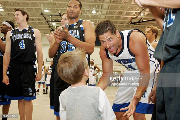 Actor Joe Manganiello greets Jackson Brundage at The 5th Annual James Lafferty/One Tree Hill Charity Basketball Game held on Saturday April 26th on...