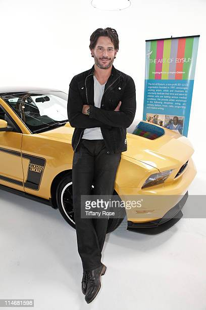 Actor Joe Manganiello poses at the Ford Mustang Boss workshop for Art Of Elysium on May 25 2011 in Los Angeles California