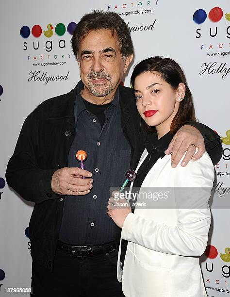Actor Joe Mantegna and actress Gia Mantegna attend the grand opening of Sugar Factory Hollywood on November 13 2013 in Hollywood California